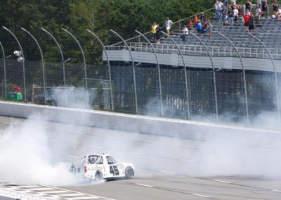 Ross Chastain does a burnout after taking the checkered flag in his Acurlite sponsored race truck at the conclusion of the NASCAR Gander Outdoors Truck Series race at Pocono Raceway.